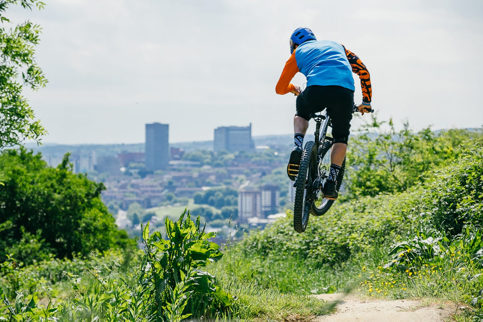 Cyclist overlooking Sheffield