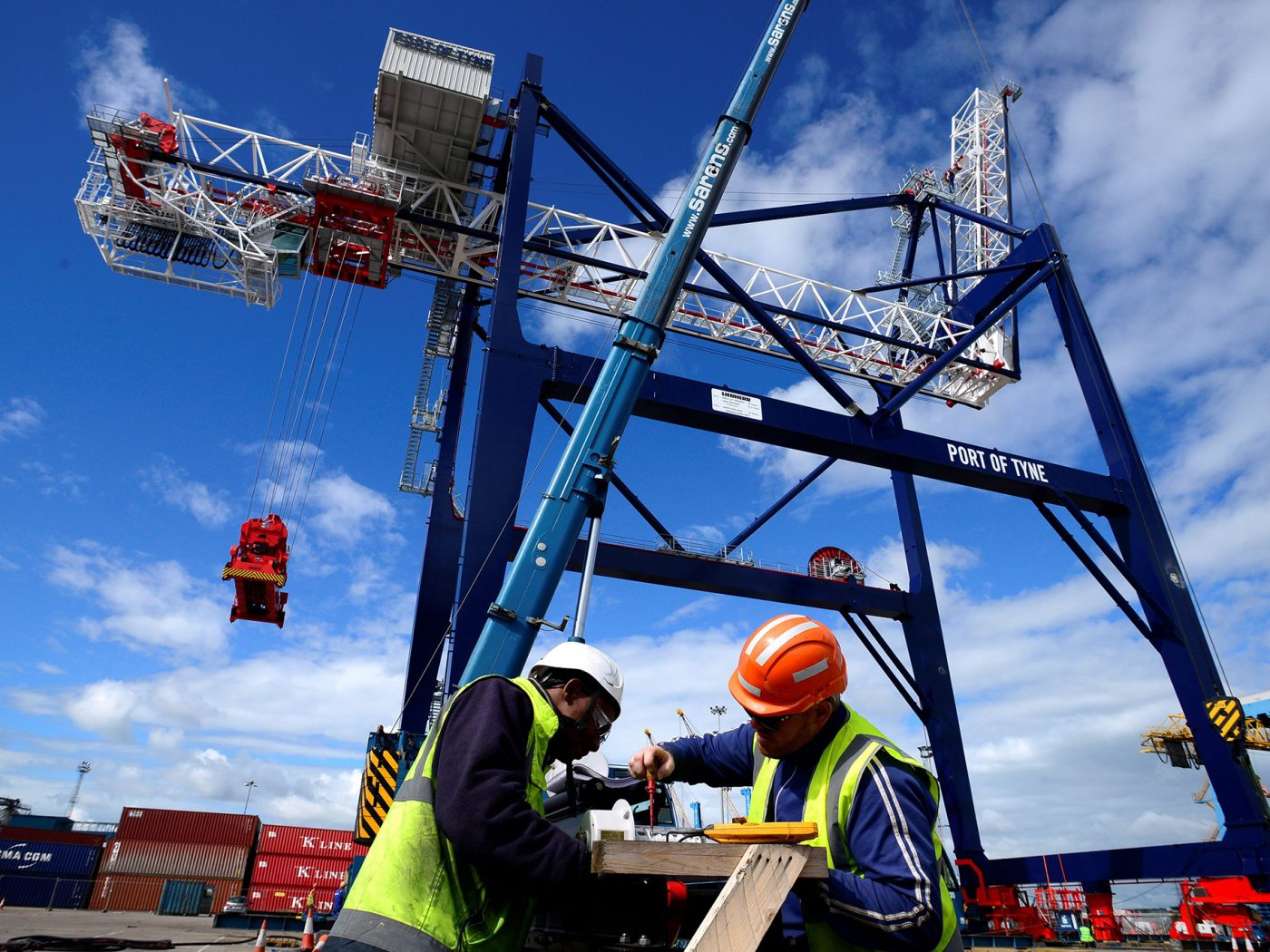 Workers and a crane at the Port of Tyne